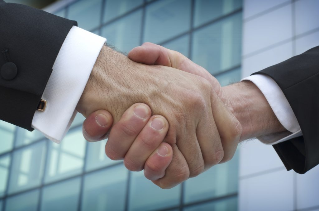 businessmen-handshake-business-corporate